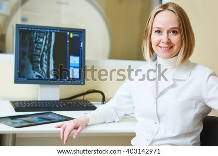 female tomography or MRI tesr doctor portrait - stock photo