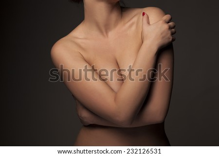 female torso with hands covering breasts - stock photo