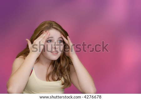 Female touching her forehead to relieve pain - stock photo