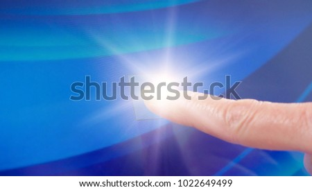 Female touching modern touch screen laptop computer monitor, with lens flare.