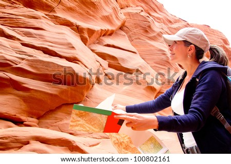 Female tourist at the Grand Canyon holding a map - stock photo