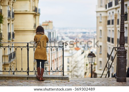 Female tourist enjoying city view on a street of Montmartre, Paris, France - stock photo