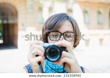 female tourist photographing - stock photo