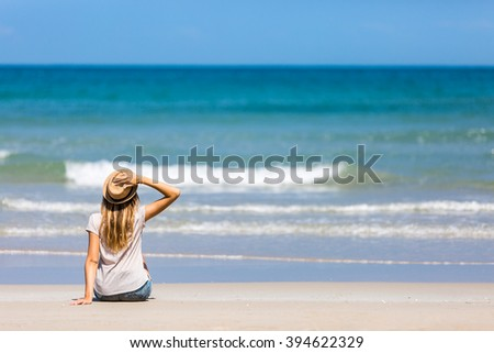 Female tourist relaxing on the beach - stock photo