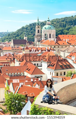 Female tourist resting.Against the background of the Prague castle - stock photo