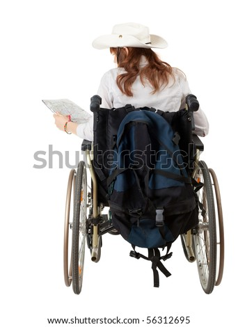 female tourist with map on the wheelchair - stock photo