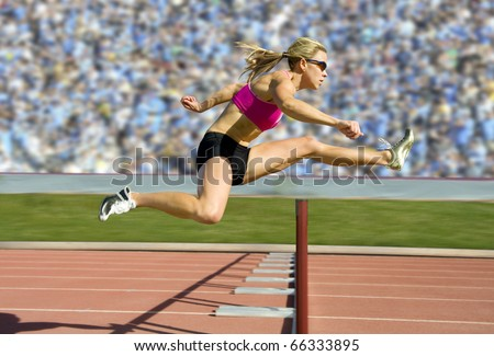 Female track and field athlete hurdling. - stock photo