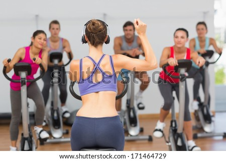 Female trainer and fitness class at class in gym - stock photo