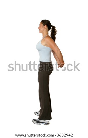 Female trainer doing back stretch, both arms pulled behind to stretch the back muscle and top of arm, isolated on white - stock photo