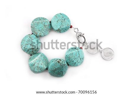Female turquoise bracelet isolated on white - stock photo