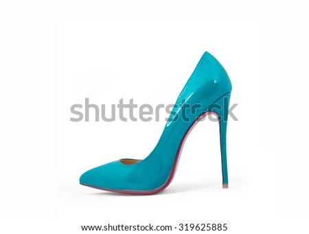 Female turquoise high-heeled shoes - stock photo
