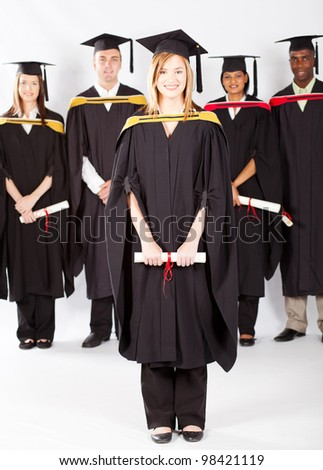 female university student at graduation with classmates