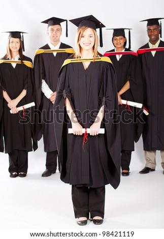 female university student at graduation with classmates - stock photo