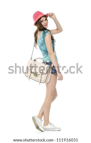 Female university student in hat with bag isolated on white background. - stock photo
