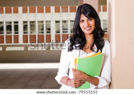 female university student inside campus building - stock photo