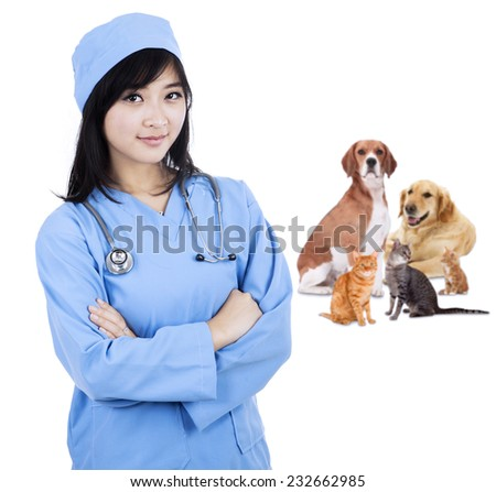 Female vet smiling with pet - isolated over a white background - stock photo