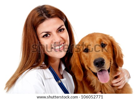 Female vet with a beautiful dog - isolated over a white background - stock photo