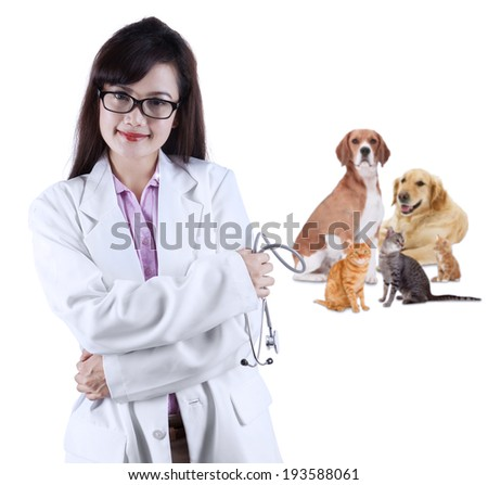 Female vet with pet - isolated over a white background - stock photo