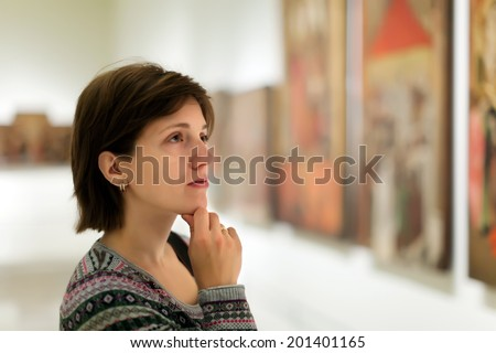 Female visitor in art gallery - stock photo