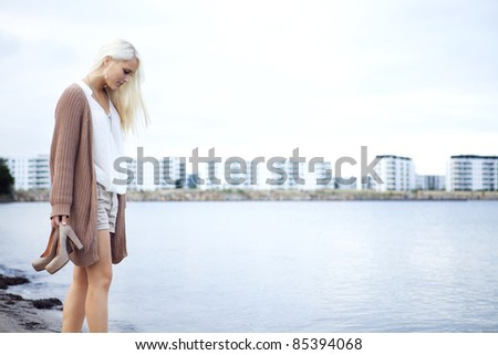 Female wading at the shore - stock photo