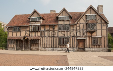 Female Walking in Front of The Birthplace of William Shakespeare on Henley Street in Stratford upon Avon, Warwickshire, England, UK - stock photo