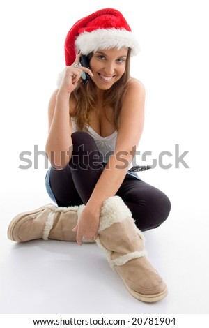 female wearing christmas hat and talking on mobile on an isolated white background - stock photo