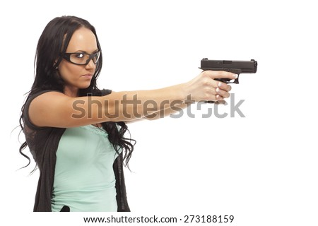 Female wearing eye protection aiming with pistol on white background. - stock photo