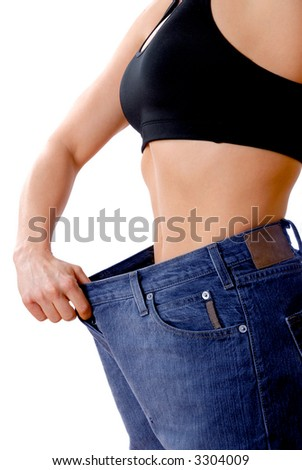 female wearing old jeans who has lost weight