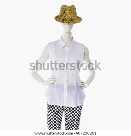 female white clothing with hat on mannequin