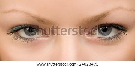female wide open eyes with long eyelashes macro - stock photo