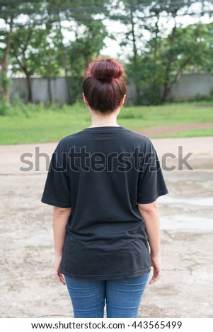 female with blank black shirt, back. - stock photo