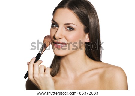 female with makeup brush