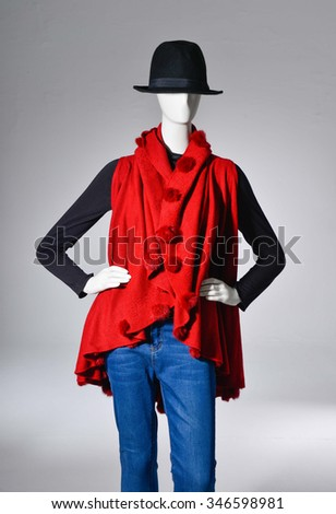 female with red dress in hat on mannequin - stock photo