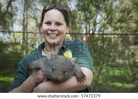 Female with Wombat in arms - stock photo