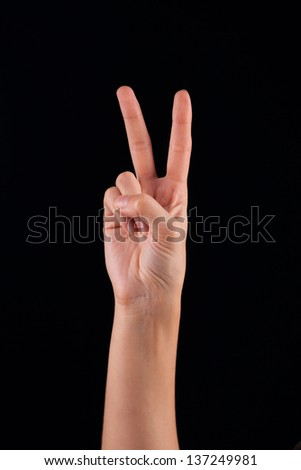 Female woman hand  on the dark background - stock photo