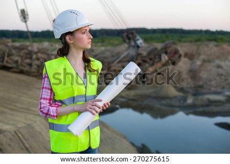 female worker stands with drawings on a background of career Stacker - stock photo