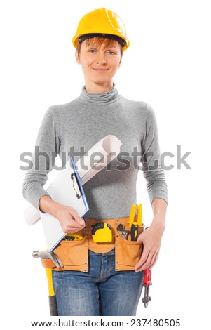 Female worker with construction tools holding clipboard and blueprint looking at camera isolated on white background - stock photo
