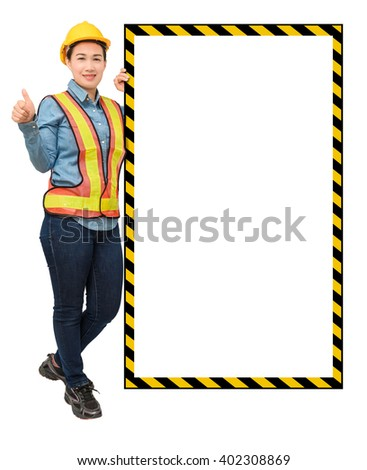 female worker with Protection Equipment, posing side of big white banner, thumb up and looking at camera and copy space, isolated on white background - stock photo