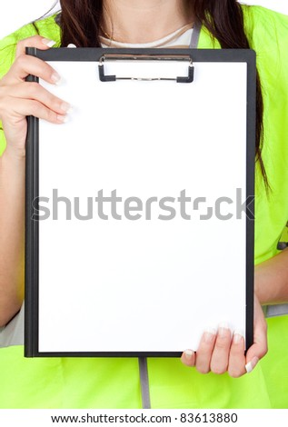 Female worker with reflector vest showing a blank paper - stock photo