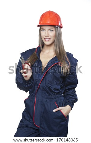 Female worker with safety helmet holding old pilers isolated on white background - stock photo
