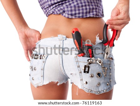 Female  worker with tools in back pocket on shorts on a white background. - stock photo