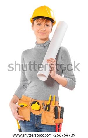 female worker with tools in tolbelt holding big rolleed blueprint standing and looking at camera isolated on white  - stock photo