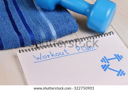 Female Workout plan, dumbbells and spot t shirt . Woman weight loss, body toning concept. Fitness, sport, challenge background