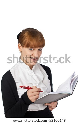 Female writing in organiser isolated on white background - stock photo