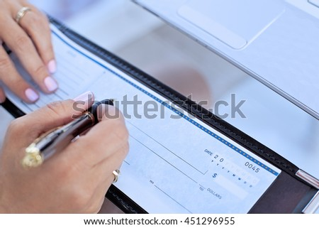 Female writing out a check