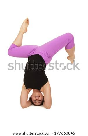 female yoga model posing in headstand splits  stock photo