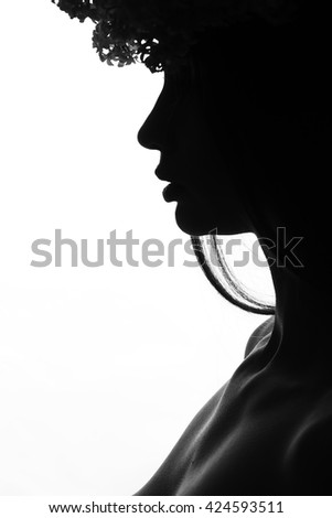 Female young and sexy woman in lilac wreath dark silhouette isolated on white background