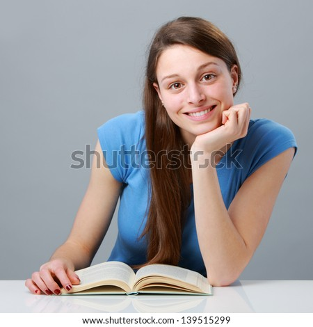 Female young student with book - stock photo