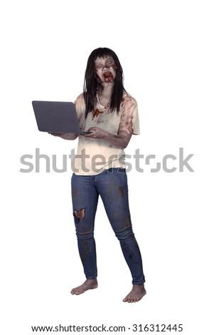Female zombie holding laptop isolated over white background - stock photo