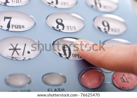females finger pressing zero on blue phone - stock photo